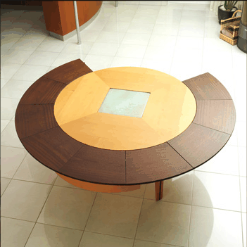 But Philippe Braun has designed a patented expandable circular dining table
